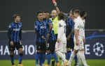 Real Madrid leave Inter on brink of elimination as Vidal sees red